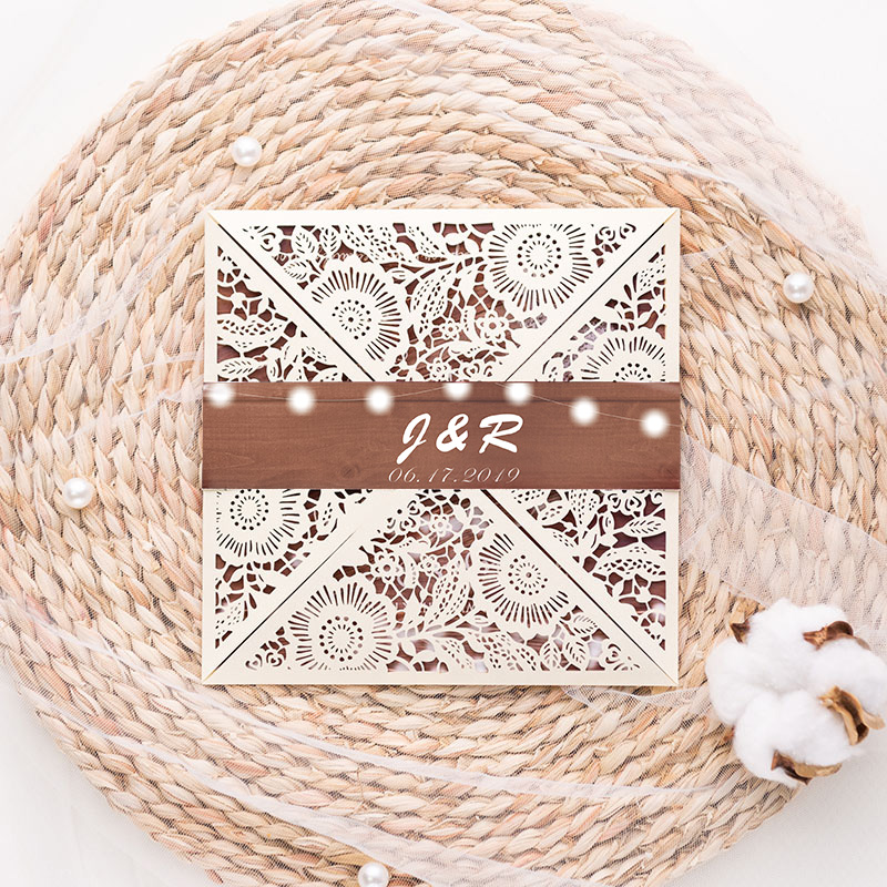 rustic ivory laser cut wedding invite with wooden background and Baby\'s Breath pattern and string light insert PWIL009