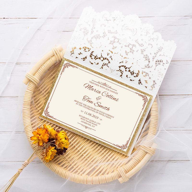 35555df7dad67 elegant ivory shimmer laser cut wedding invite with gold glittery  backer,side pocket and bling