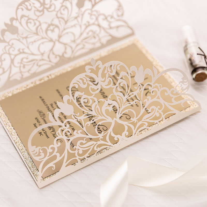 simple ivory shimmer laser cut wedding invite with champagne glitter bottom card and classic insert PWIL020