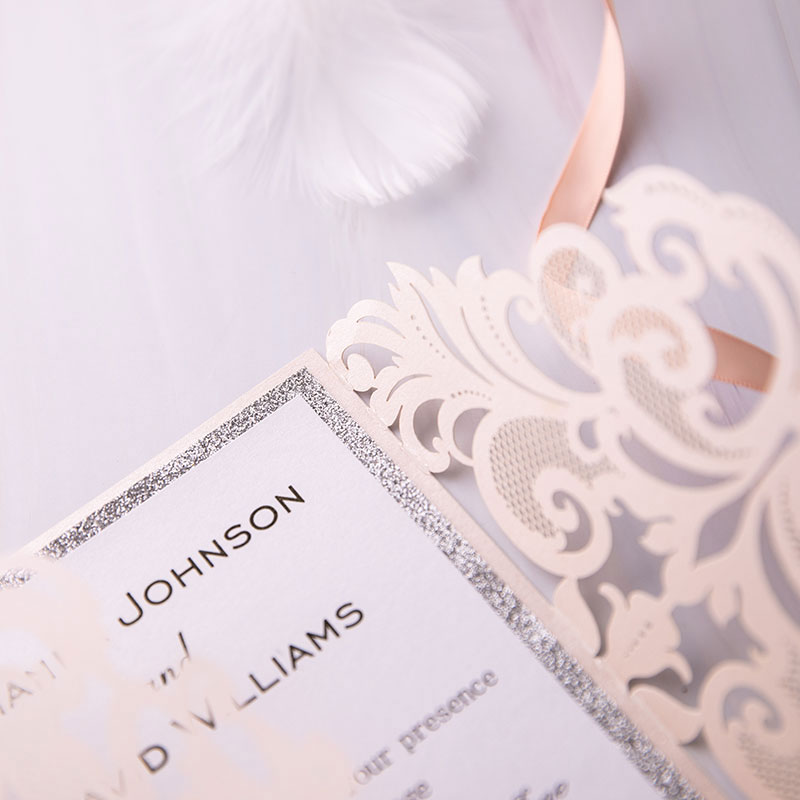 gorgeous blush shimmer laser cut wedding invite with silver glittery backer and belly band PWIL012