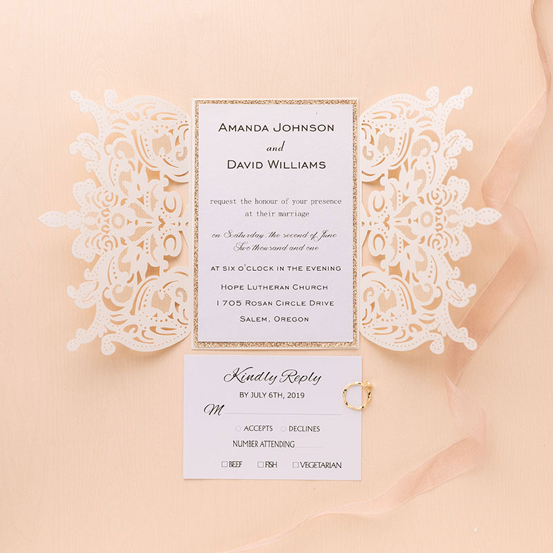 flourish ivory shimmer laser cut wedding invite with rose gold glittery backer and peacn ribbon PWIL018
