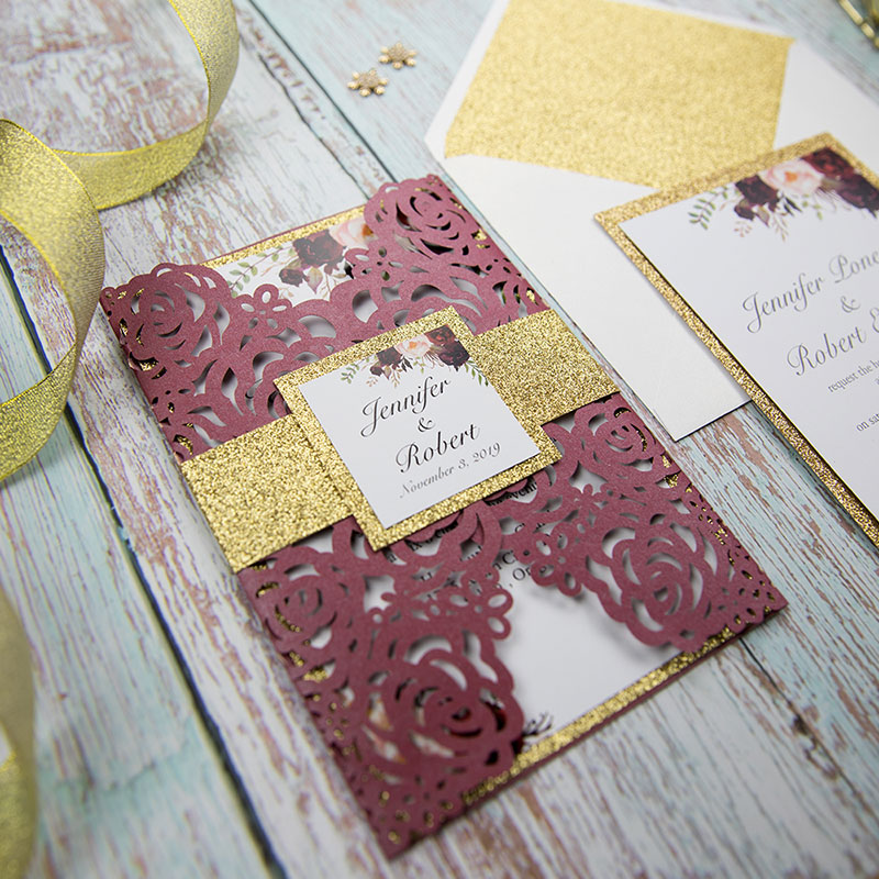 burgundy shimmer rose pattern laser cut wrap with burgundy floral inspired wedding invitation and gold glittery belly band PWIL046