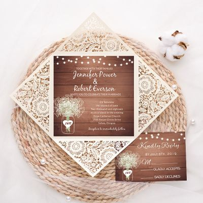 rustic ivory laser cut wedding invite with wooden background and Baby's Breath pattern and string light insert PWIL009