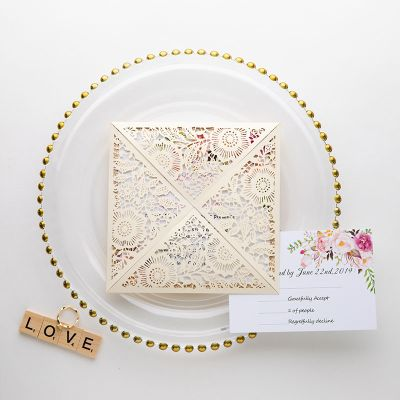 delicate ivory shimmer laser cut wedding invite with rose gold glittery bottom card and classic floral insert PWIL013